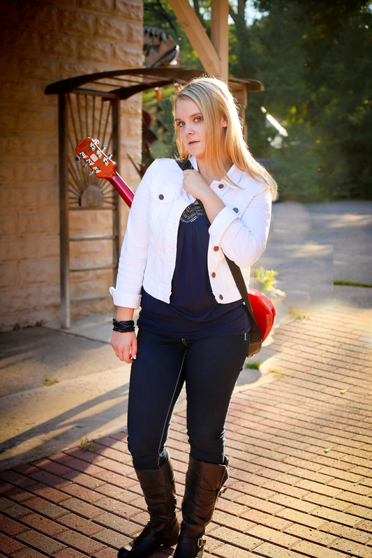 Senior portraits in downtown Milwaukee featuring electric guitar by Kelsey Jorissen Photography