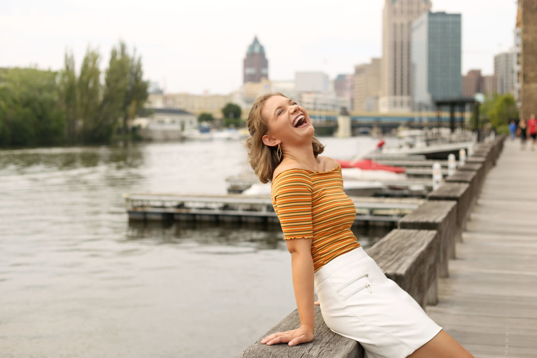 Downtown Milwaukee senior portraits along the river walk in the historic third ward by Kelsey Jorissen Photography