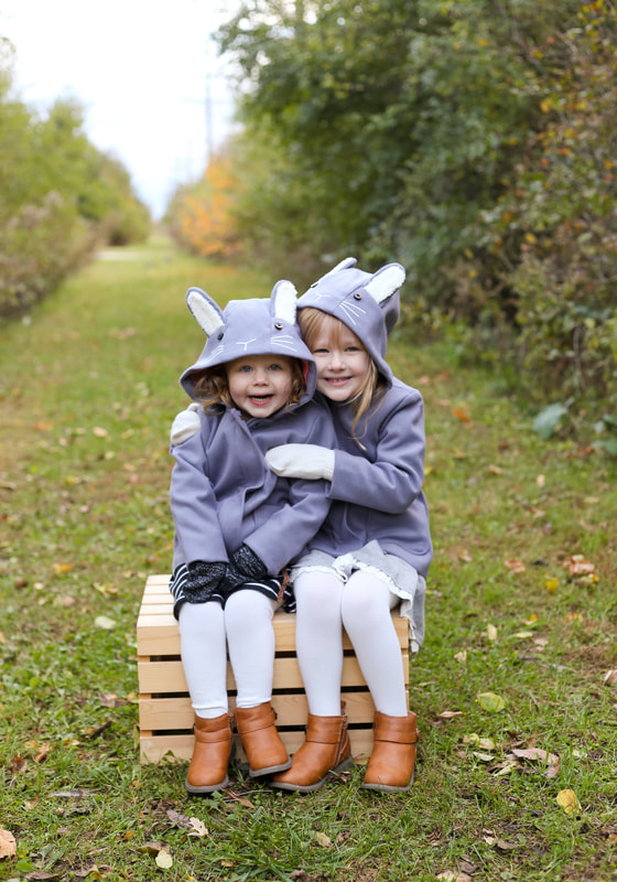 Adorable matching coats for sisters, Franklin, WI mini session family portraits with Kelsey Jorissen Photography
