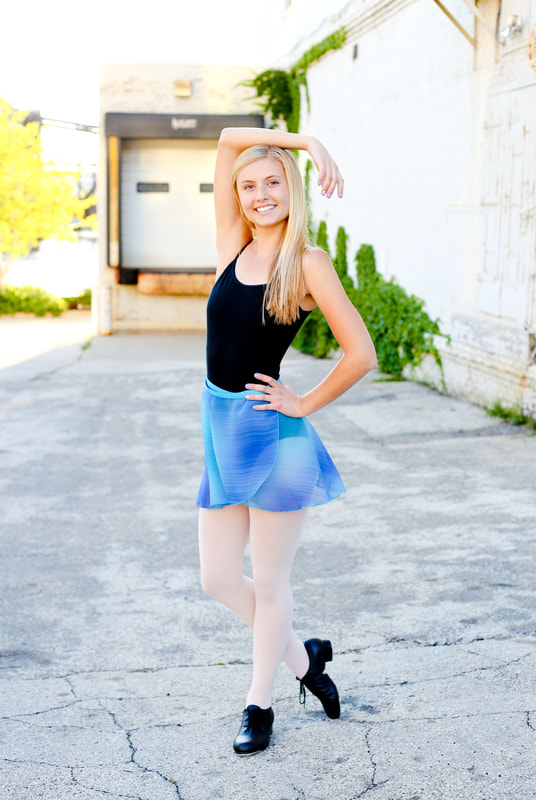 Dancer themed senior portrait shoot in downtown Milwaukee, by Kelsey Jorissen Photography