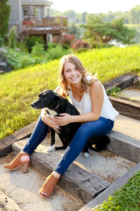 A girl and her pup, Rustic outdoor senior portrait session in Muskego, WI by Kelsey Jorissen Photography