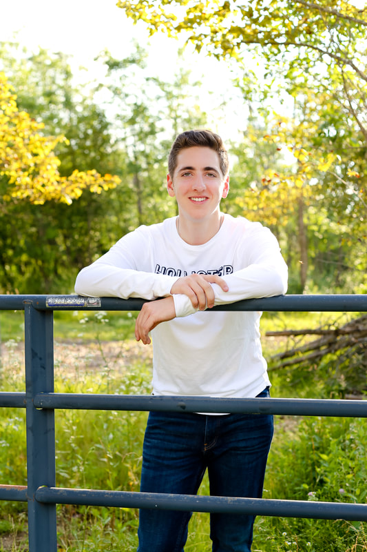 Rustic Senior Portrait with old farm gate in Franklin, WI for Pius XI High School, by Kelsey Jorissen Photography