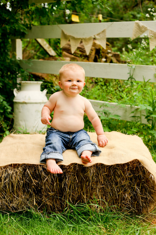 Rustic baby portraits using hay bales, an apple box, and burlap, by Kelsey Jorissen Photography