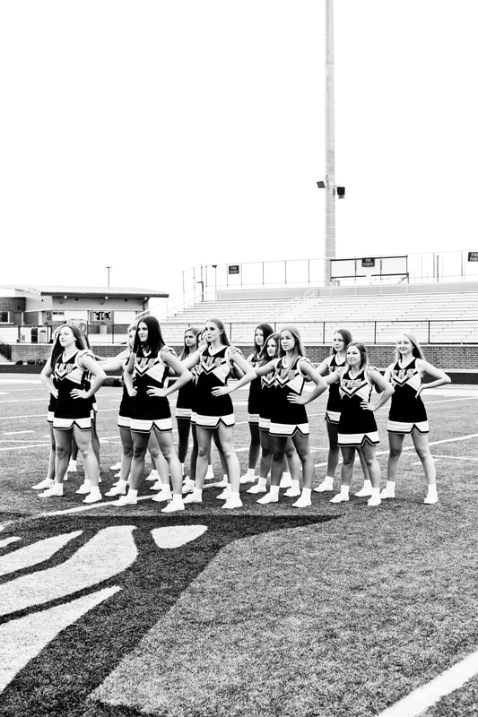 The Franklin High School Dance Team, sport portraits on the football field in uniform in black and white, by Kelsey Jorissen Photography